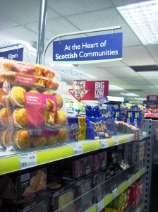 Inside a Scotmid store showing sign reading 'At the Heart of Scottish Communities'