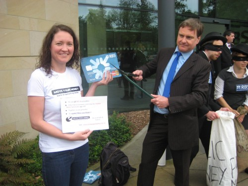 Carly and Eric chop up an oversize RBS card outside the RBS AGM.